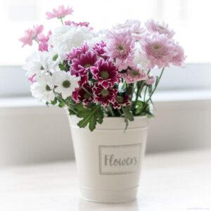Flower bouquet in a white bucket
