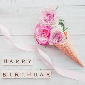 Birthday ice cream with beautiful pink roses