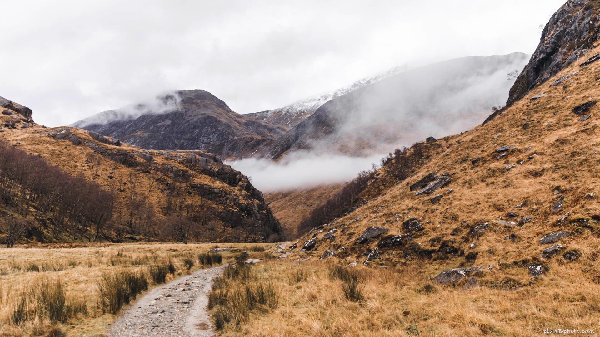 Orange foggy mountain peaks in Scotland