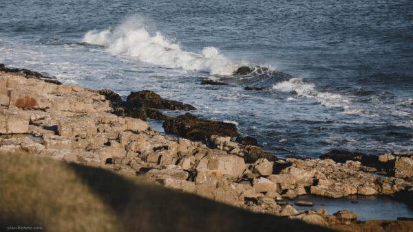 Rocks on a seashore with big waves
